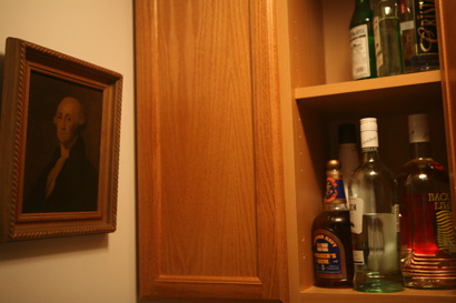 George overseeing the liquor cabinet